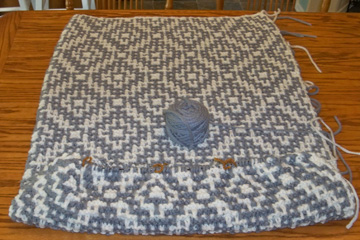 Mosaic blanket being knit on table