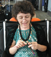Here I am in the airport, excited about learning to knit!